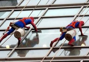 At a children's hospital in London, window washers have a clause in their contract requiring them to wear super hero costumes. They report it to be the highlight of their week.