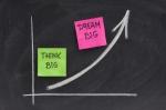 think big, dream big concept on blackboard
