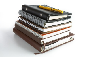 stack of ring binder book or notebook
